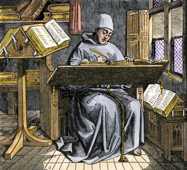 Scribe copying manuscripts in the Middle Ages